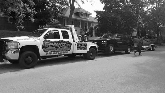 One of our drivers towing a car in joliet